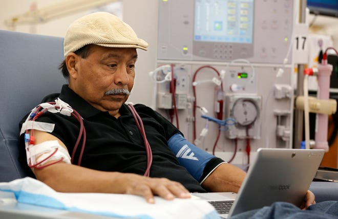 In this Sept. 24 file photo, Adrian Perez undergoes dialysis at a DaVita Kidney Care clinic in Sacramento.