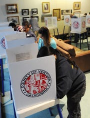 Voters cast their votes at Camarillo City Hall on the evening of Election Day.