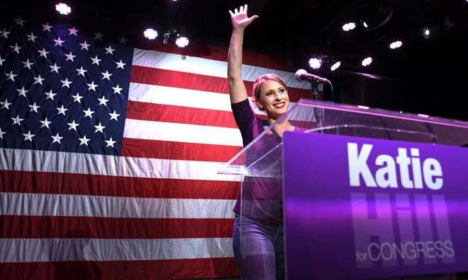 Congressional candidate Katie Hill waves to supporters at an election watch party in Valencia late Tuesday night.