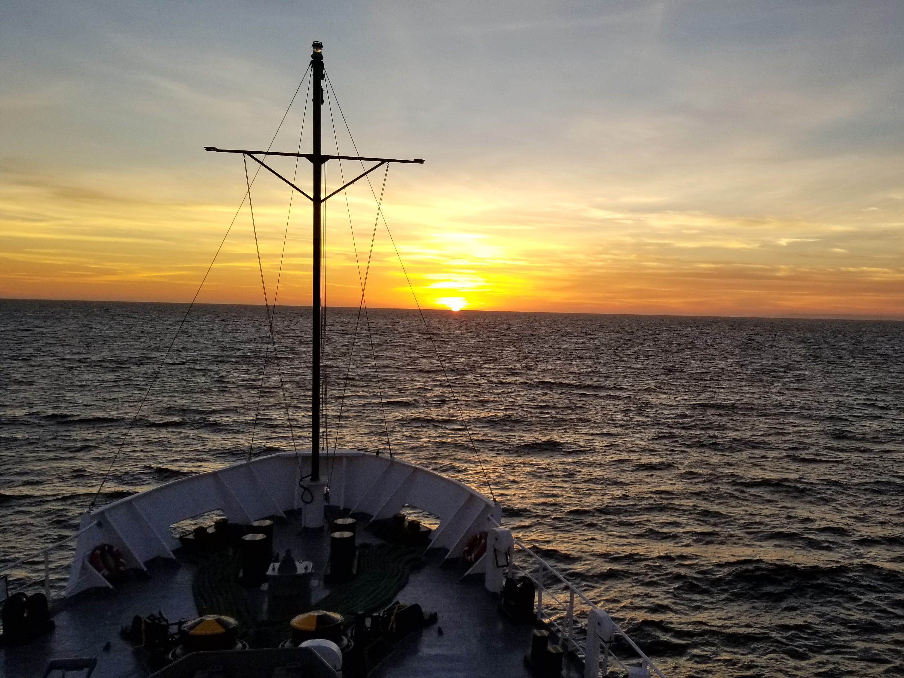 The final sunset, viewed over the bow. Santa Cruz Island is just visible to the right.