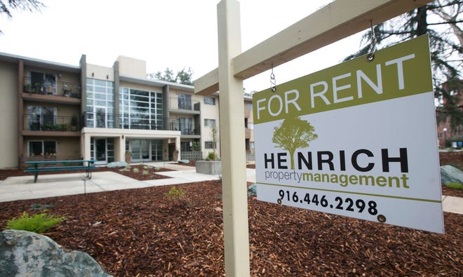 "In this Jan. 8 file photo, a ""For Rent"" sign is posted outside an apartment building in Sacramento."