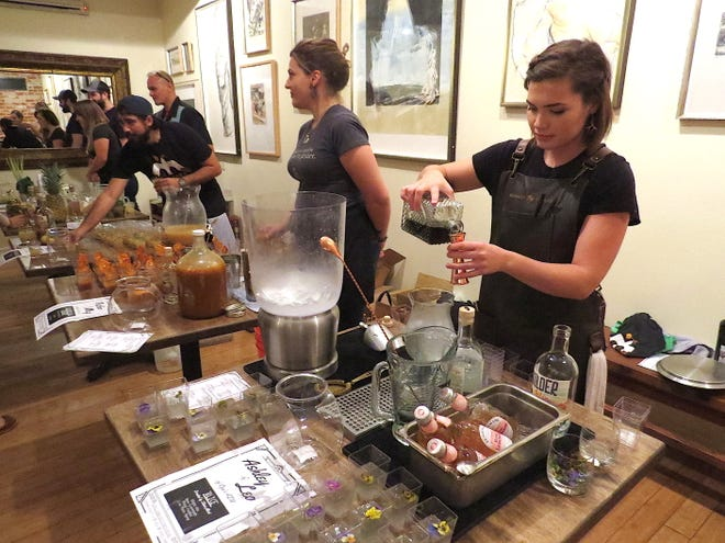 Ashley Proffitt, far right, a bartender at Azu Restaurant in Ojai, mixes a cocktail during Libation Creation. The fundraiser benefited efforts to publish a storybook written by local children affected by the Thomas Fire.