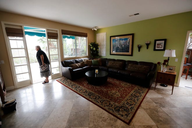 In this Oct. 3 image, Vicky Campbell looks around a home for sale in her former neighborhood during an open house in Chula Vista. Campbell, a 68-year-old real estate broker, was able to bring her low property taxes along when she bought in the neighborhood years ago, utilizing a tax rule. Proposition 5 would have sharply expanded the tax benefit.