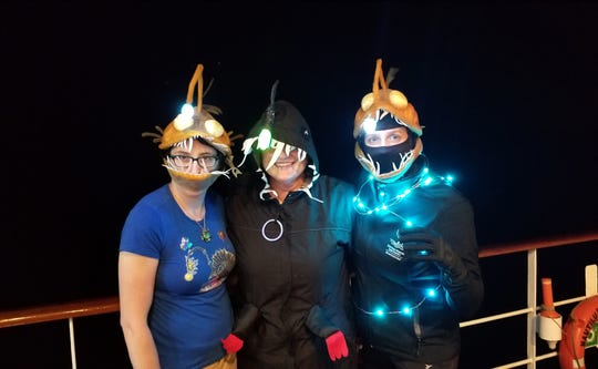 Melissa Baffa, center, shows off her Halloween spirit with like-minded anglerfish shipmates Jamie Wagner and Amity Wood.