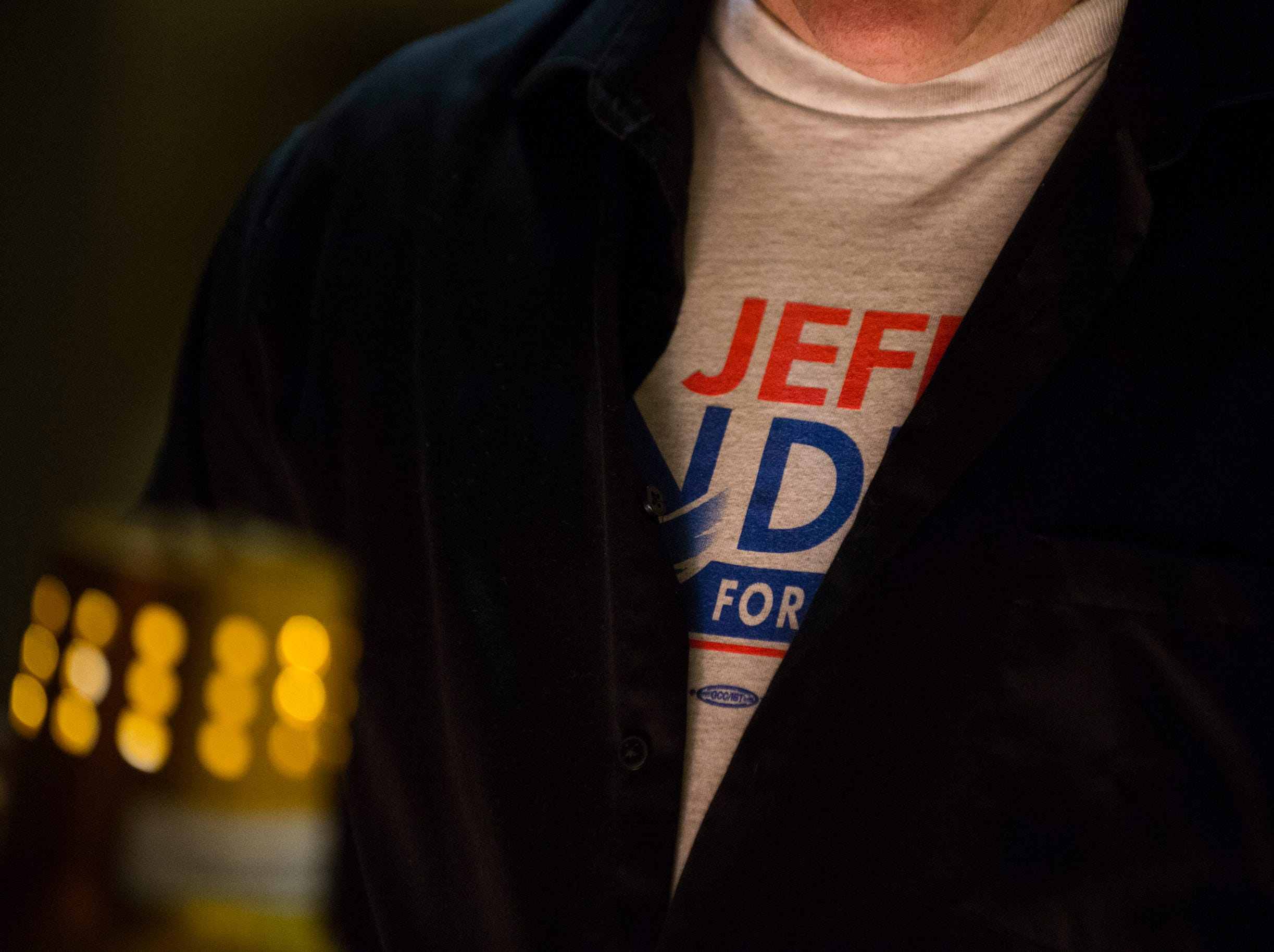 A Jeff Van Drew supporter waits in line for food inside the election nigh headquarters Tuesday, Nov. 6, 2018 at The Claridge Hotel in Atlantic City, N.J.