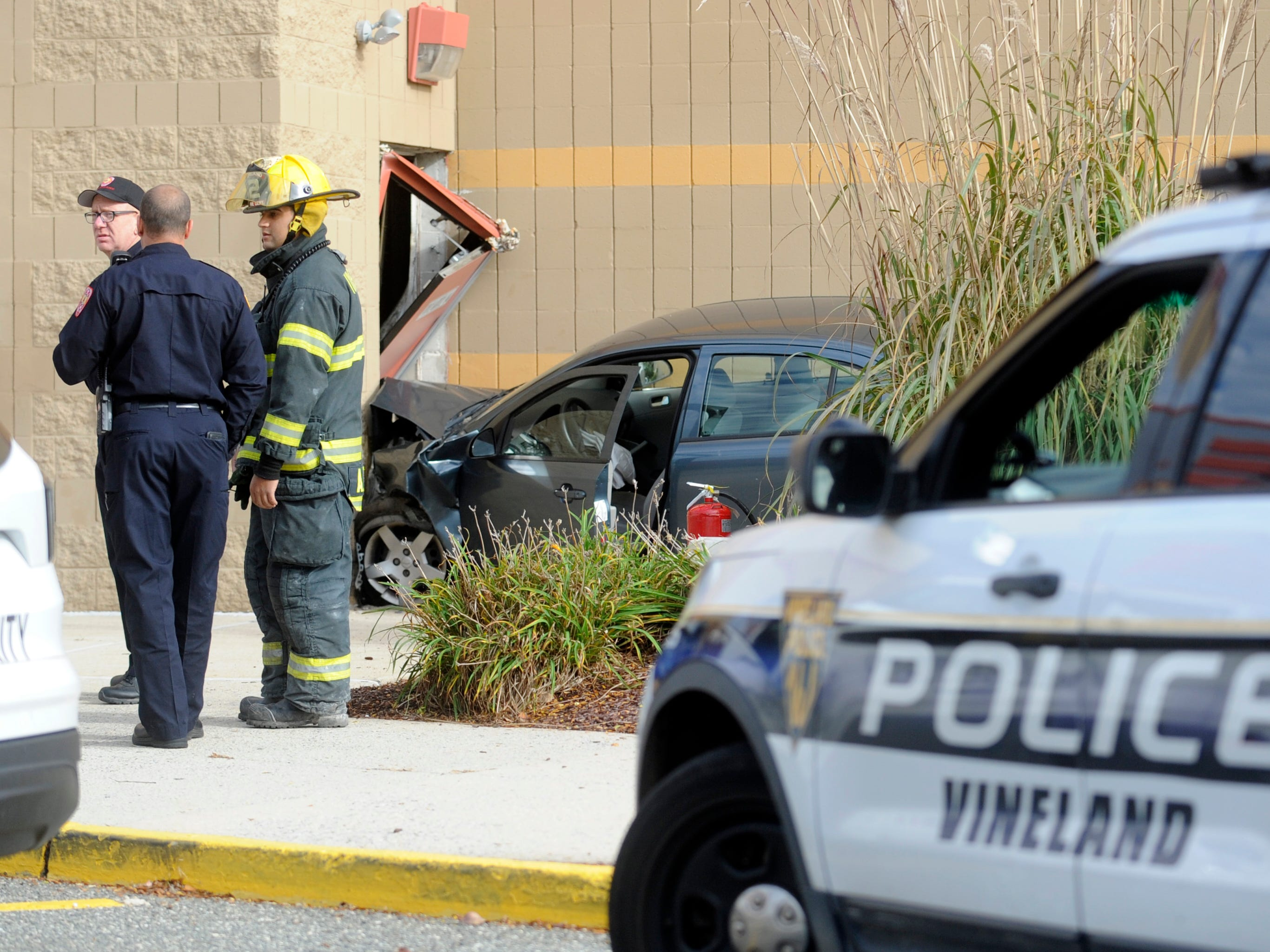 Vineland emergency crews were on the scene of a car that crashed into the Regal Cumberland Mall Stadium 14 movie theater on Wednesday, November 7, 2018.
