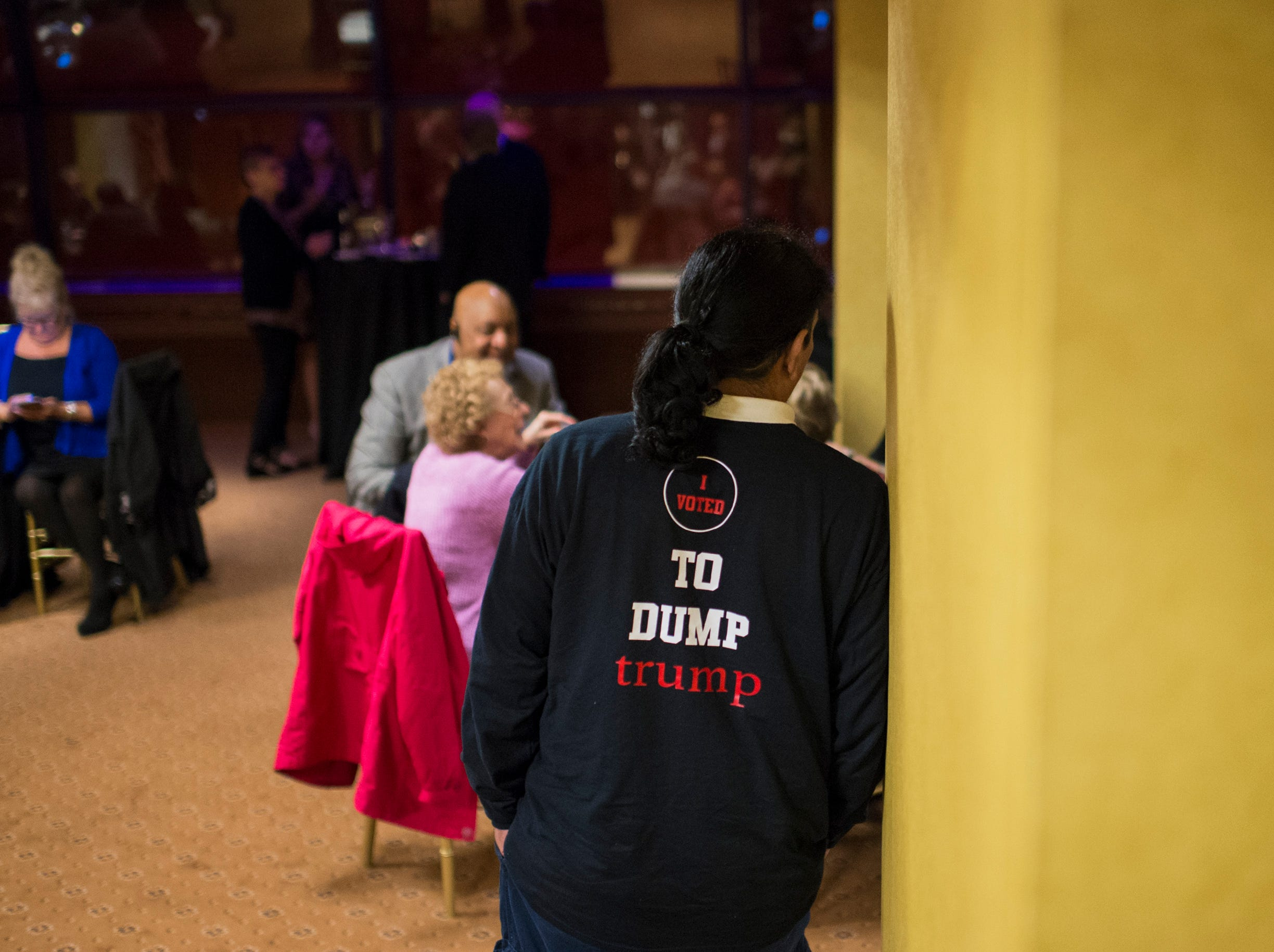 Alexander Morales of Pleasantville wears a sweatshirt reading 'I voted to dump Trump' at the election night headquarters for NJ Sen. Jeff Van Drew, D-1, Tuesday, Nov. 6, 2018 at The Claridge in Atlantic City, N.J.
