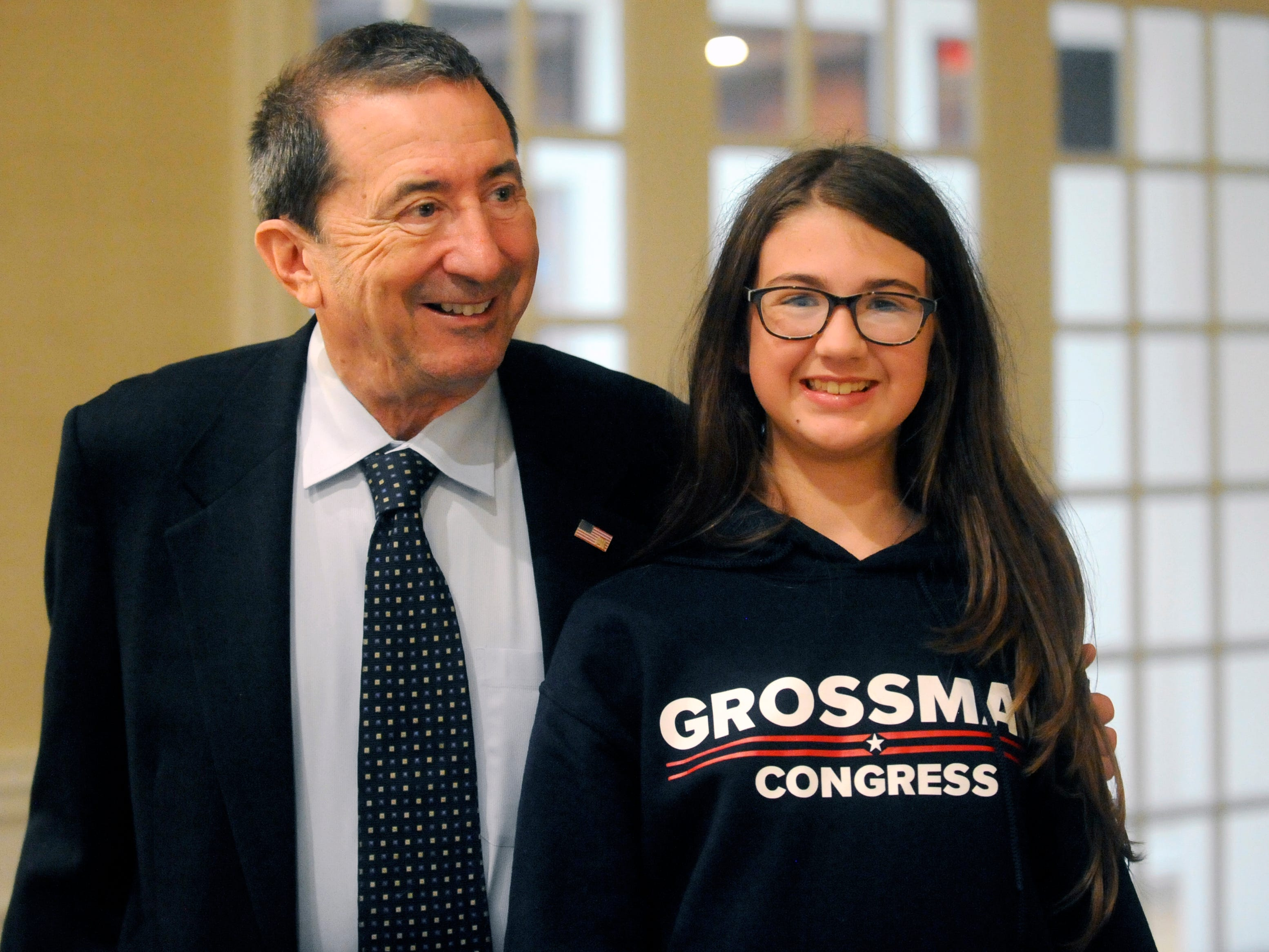 2nd Congressional District candidate Seth Grossman stands with 13-year-old Alexis Fisher on election night at Linwood Country Club in Linwood, NJ on Tuesday, November 6, 2018.