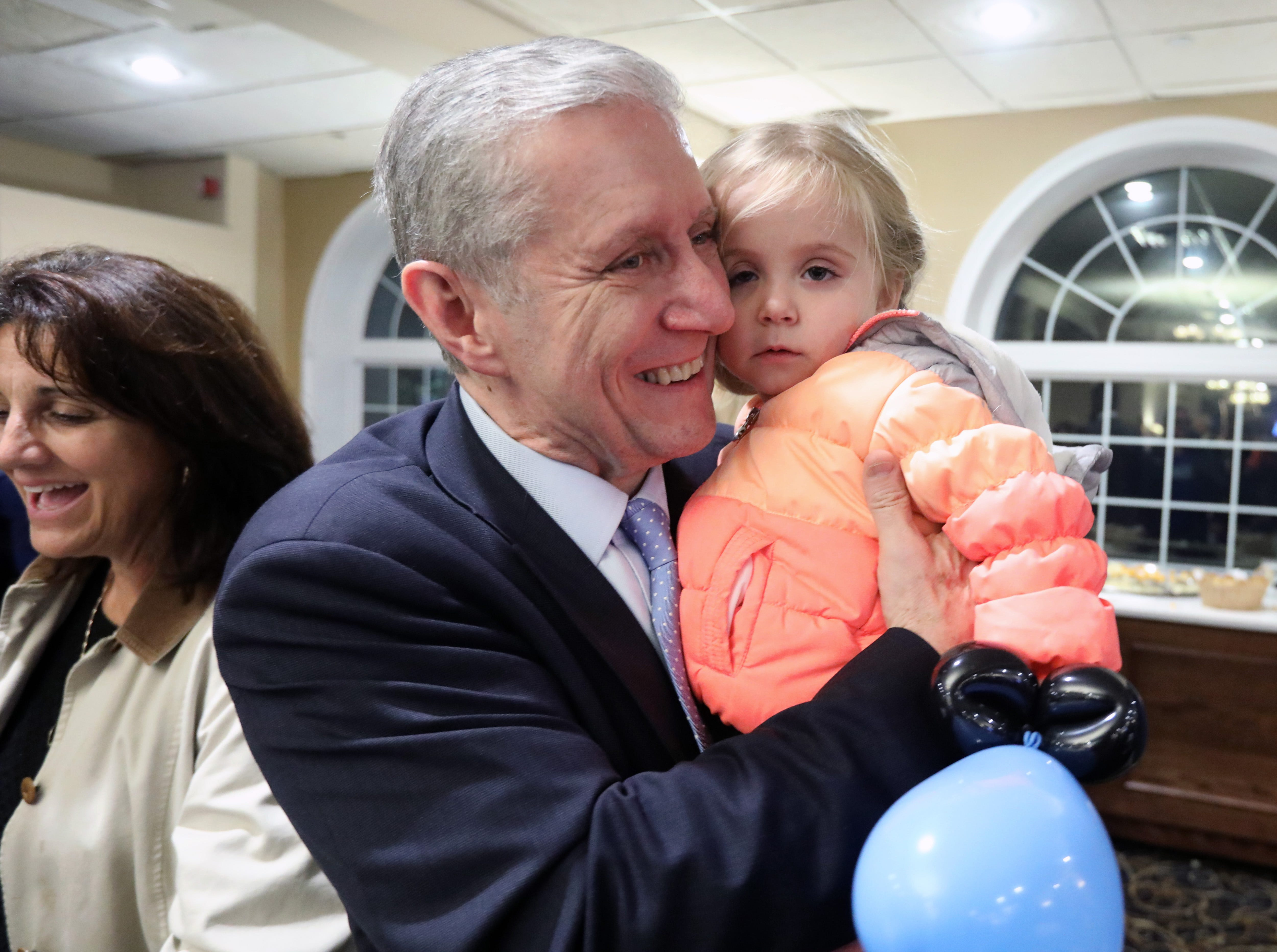Thomas Zugibe, candidate for Supreme Court Justice 9th district, hugs his granddaughter Abigail Munson, 2, of Stony Point as the Rockland County democrats wait for election results at Casa Mia in Blauvelt Nov. 6, 2018.