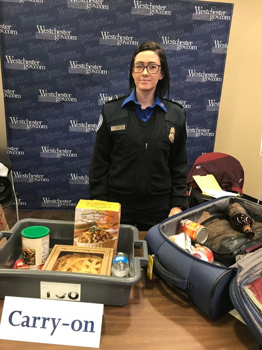 Tara Gavin, a TSA agent at the Westchester County Airport shows what foods can go in your carry-on and what should go in your suitcase.