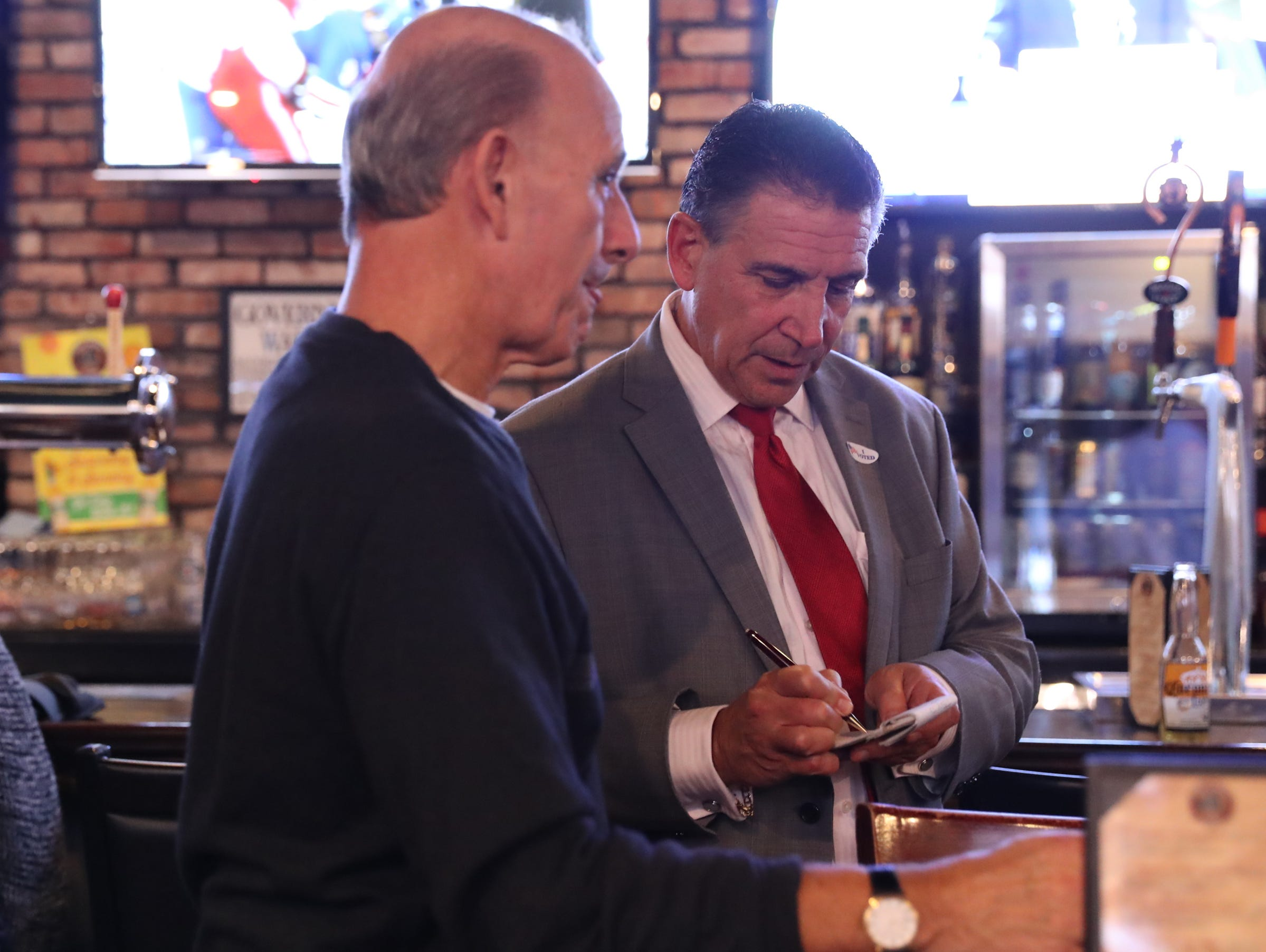 Rockland County legislator Lon Hofstein takes notes at the Rockland Republican Commitee's election night gathering at Foggy Bottom Tavern in New City on Tuesday, November 6, 2018.