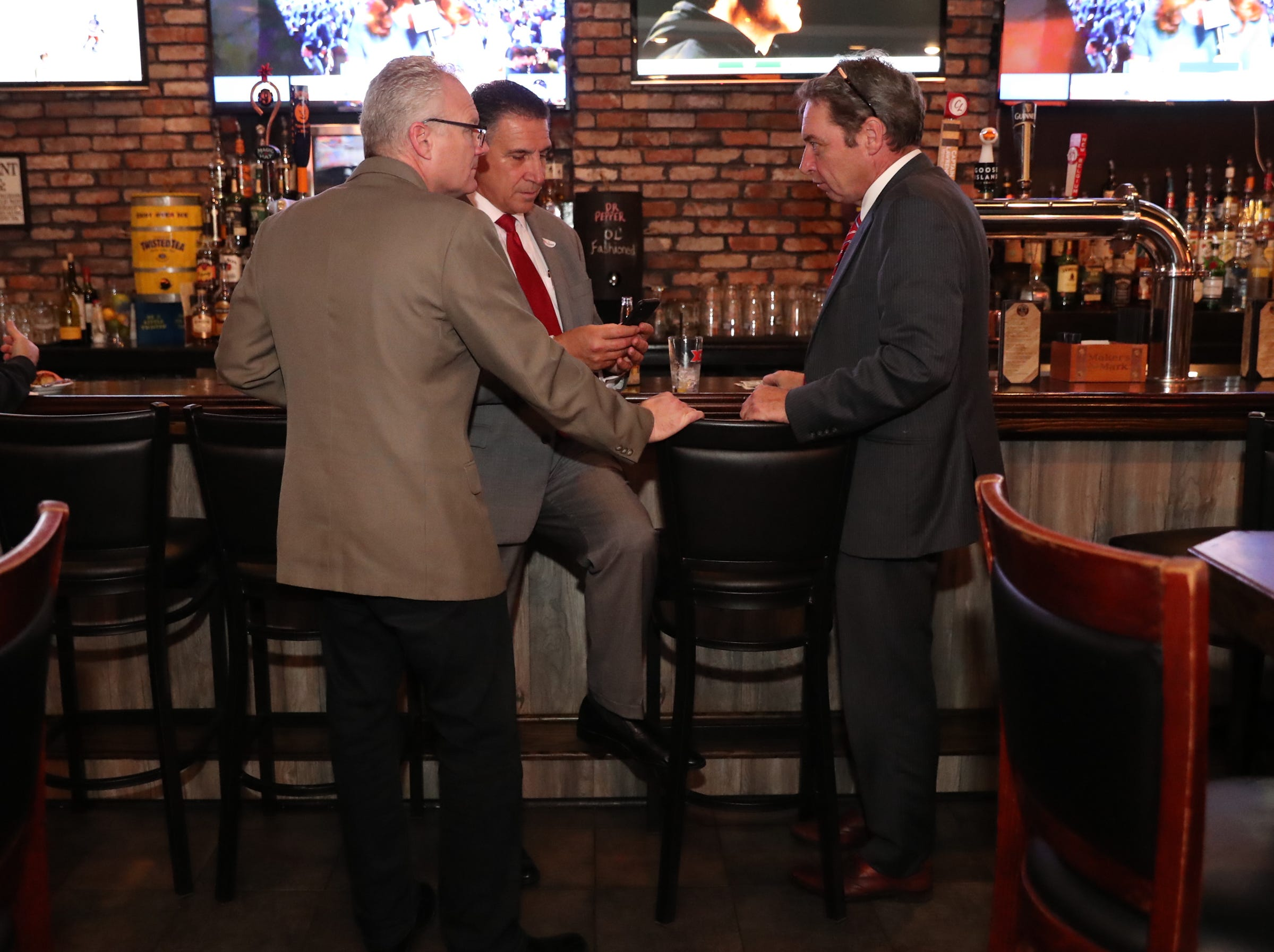 Scott Milich, left, Rockland County Legislator Lon Hofstein and Rocland County Rebublical commitee chairman Lawrence Garvey wait for election results at the Rockland Republican Commitee's election night gathering at Foggy Bottom Tavern in New City on Tuesday, November 6, 2018.
