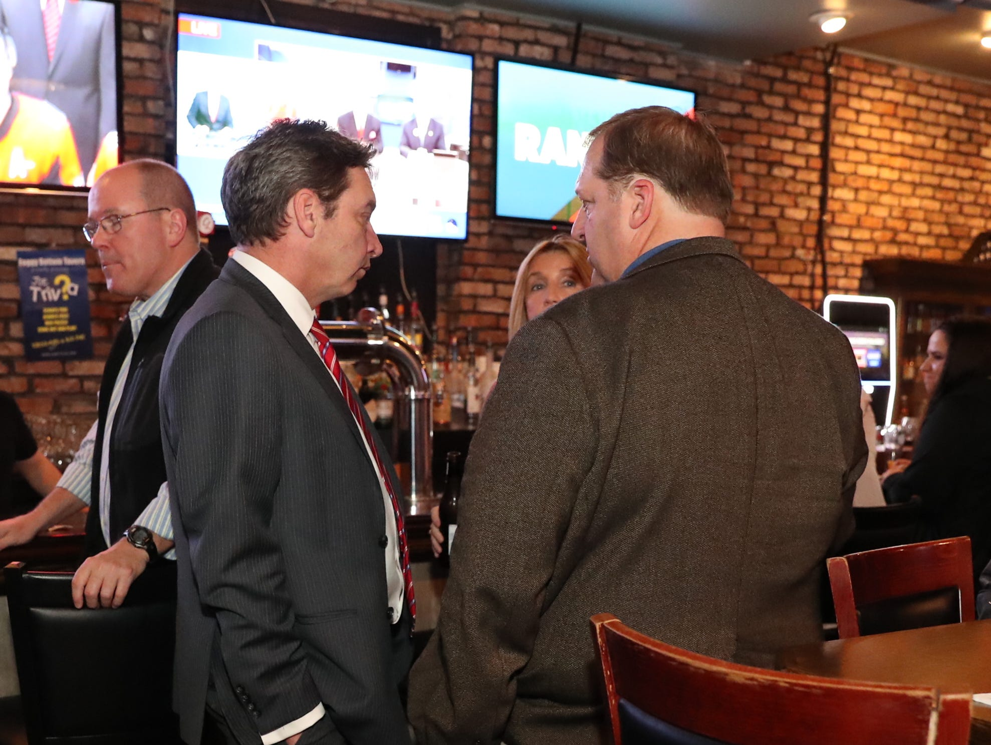 Rockland County Reublican Commitee Chairman Lawrence Garvey, left, and Clarkstown Supervisor George Hoehman meet at the Rockland Republican Commitee's election night gathering at Foggy Bottom Tavern in New City on Tuesday, November 6, 2018.