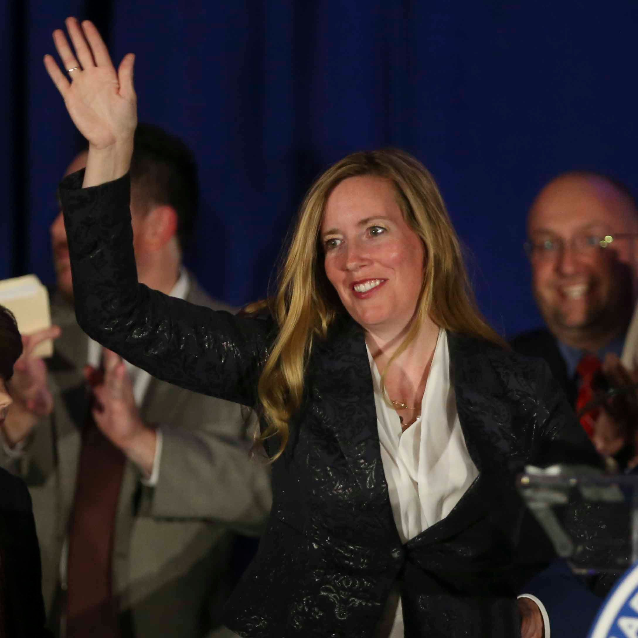 Colleen C. Davis waves to the crowd at the DoubleTree Hotel in Wilmington after winning the state treasurer race  Tuesday.