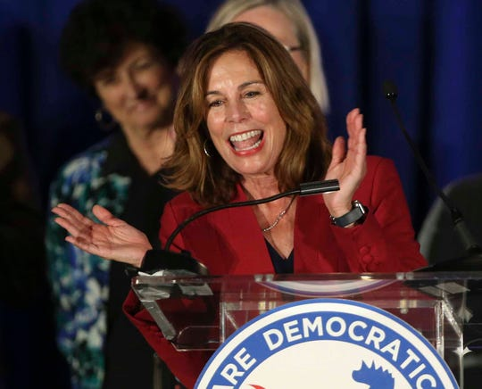 Kathleen Jennings celebrates after winning the state attorney general contest with fellow Democrats at the DoubleTree Hotel in Wilmington Tuesday.