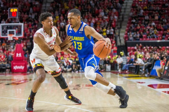 Ryan Johnson drives to the basket in Delaware's opener at Maryland.