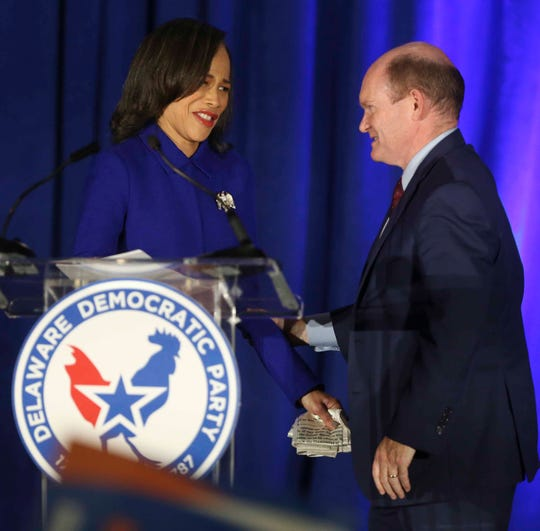 Lisa Blunt Rochester is greeted at the podium by US Senator Chris Coons after she was reelected to her seat in the House of Representatives at the DoubleTree Hotel in Wilmington Tuesday.
