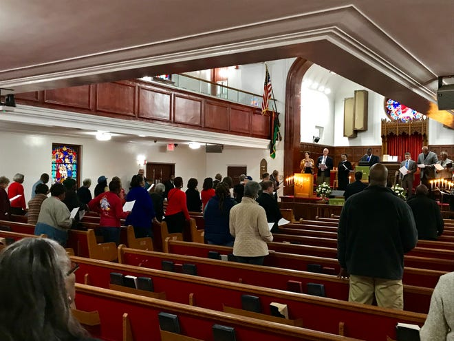 Congregants attend an interfaith prayer session at the Bethel African Methodist Episcopal Church in Wilmington to express solidarity against anti-Semitism