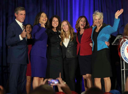 Governor John Carney and Lt. Gov. Bethany Hall-Long flank statewide Democratic women victors (from second from left) Lisa Blunt Rochester (US House), Kathy McGuiness (state auditor), Colleen Davis (state treasurer) and Kathy Jennings (state attorney general) at the DoubleTree Hotel in Wilmington Tuesday.