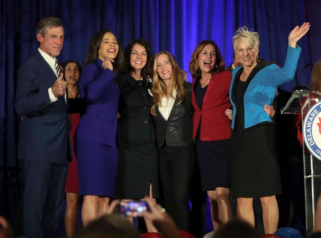Governor John Carney and Lt. Gov. Bethany Hall-Long flank statewide Democratic women victors (from second from left) Lisa Blunt Rochester (US House), Kathy McGuiness (state auditor), Colleen Davis (state treasurer) and Kathy Jennings (state attorney general) at the DoubleTree Hotel in Wilmington Tuesday, Nov. 6, 2018.