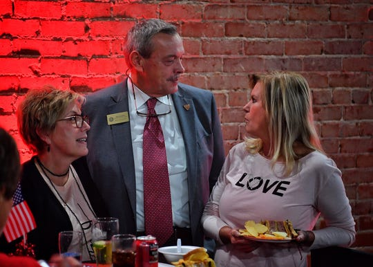 Wichita County Precinct 4 Commissioner Jeff Watts talks with Sheri Mahler, right, and his sister, Jill Gann, Tuesday evening during an election watch party at Half Pint Taproom.