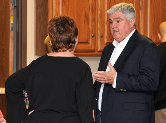 City council District 4 candidate, Tim Brewer chats with supports while waiting for polling numbers Tuesday evening.