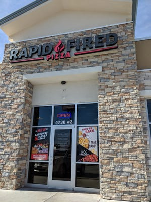 Outsided Rapid Fired Pizza on 4730 Taft Blvd.
