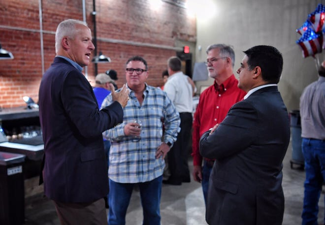 State Rep. James Frank, left, talks with Larry Ayers, Wichita County Commissioner Mark Beauchamp and Wichita Falls Mayor Stephen Santellana at an election watch party Tuesday evening at Half Pint Taproom.