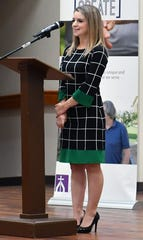 Haven Smith was a client of Catholic Charities when her husband was deployed overseas and she was a nursing student. She spoke during a fundraising luncheon for the organization Wednesday at Our Lady Queen of Peace Church.