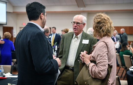 Diaz Murray, center, visits with Tony Fidelie and Colleen Foley during a fundraising luncheon for the Catholic Charities of Fort Worth's Northwest Campus Wednesday at Our Lady Queen of Peace Church.