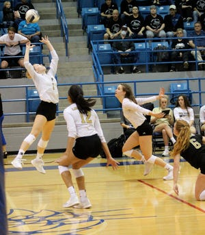 Rider's Lauren Dodson sets the ball for the Lady Raiders' attack Tuesday night against Canyon Randall.