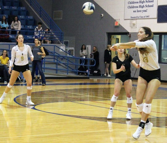 Rider's Meredith Fisher (13) and the Lady Raiders lost in three sets Tuesday night against No. 1 Canyon Randall.
