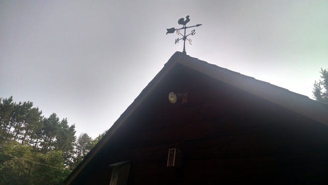 The old weather vane on top of the Apps' barn was am important tool for predicting the weather, according to Jerry Apps' father.