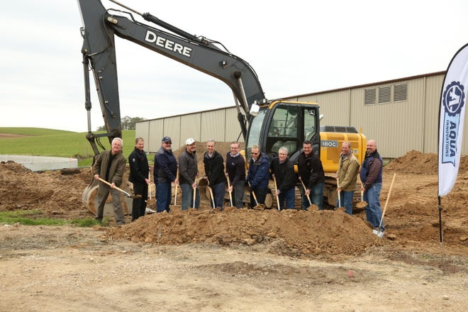 A groundbreaking of a Nutrient Concentration System (NCS), a cow manure processing system was held in Middleton. From left, Dave Merritt, Dane County director of policy & program development; Greg Ziegler, Ziegler Dairy; Art Meinholz, Blue Star Dairy; Will Hensen, Henson Brothers Dairy; Joe Parisi, Dane County Executive; Chris Lenzendorf, AQUA Innovations president; Duane Toenges, Dynamic Group; Paul Heath, Gundersen Health System; Frank Winters, AQUA Innovations director of business development; Guy Selsmeyer, Northern Biogas president; and Jeff LaViolette, Northern Biogas civil/environmental engineer.