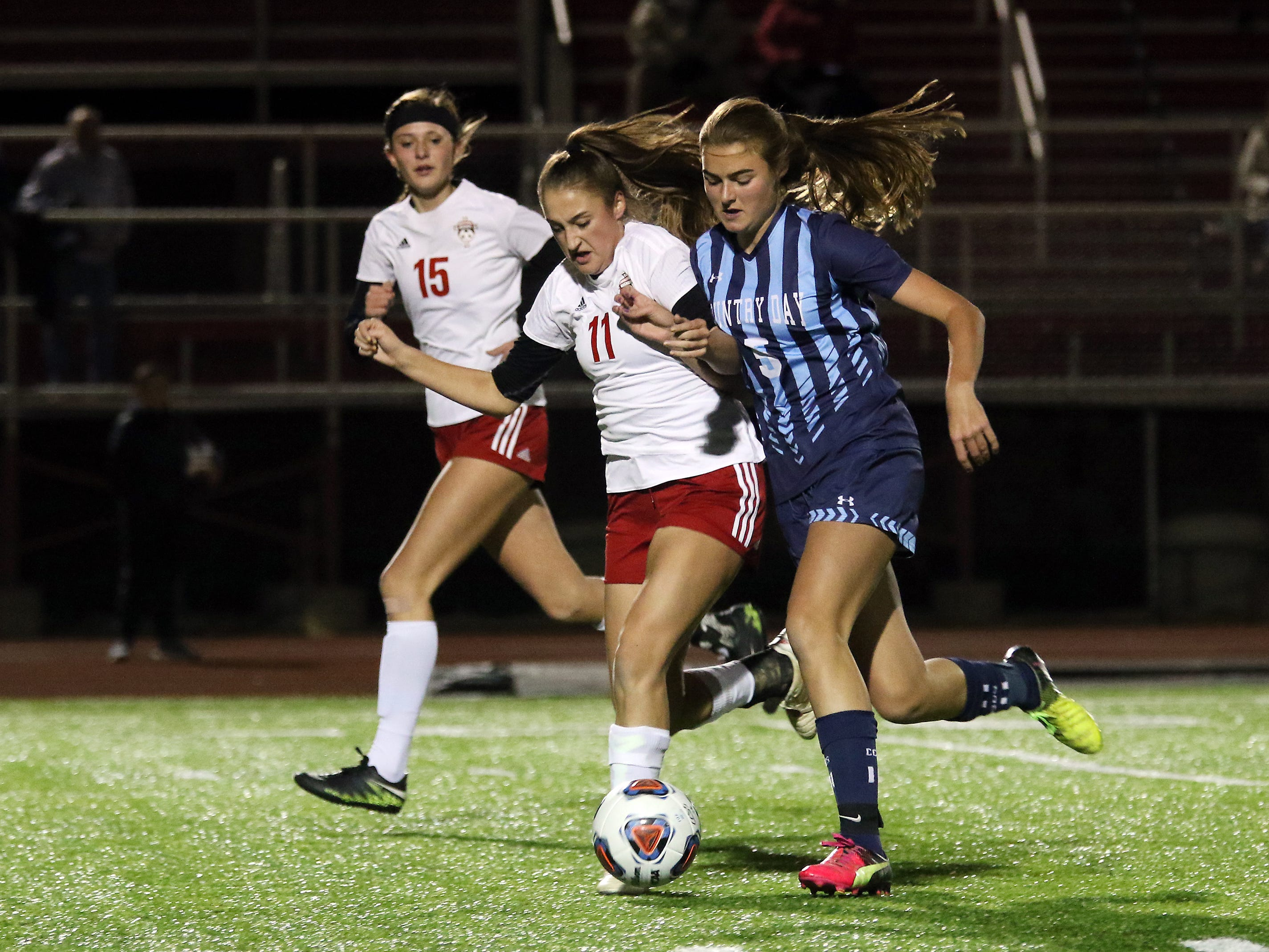 Rosecrans' Korynn Porter chases down the ball against CCD in the Division III state semifinals at London High School on Tuesday.