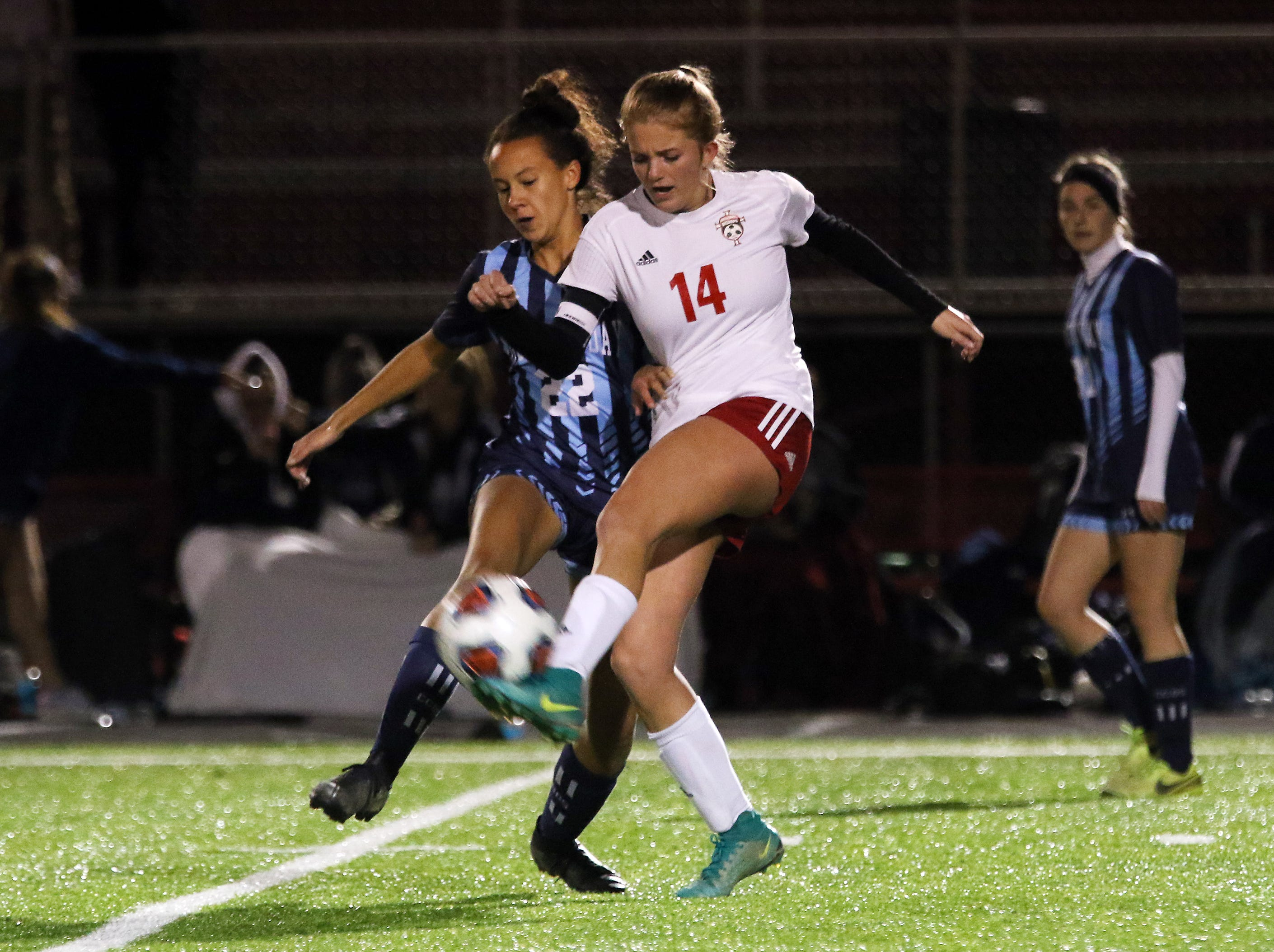 Emma Zemba passes the ball against CCD in the Division III state semifinals at London High School on Tuesday.