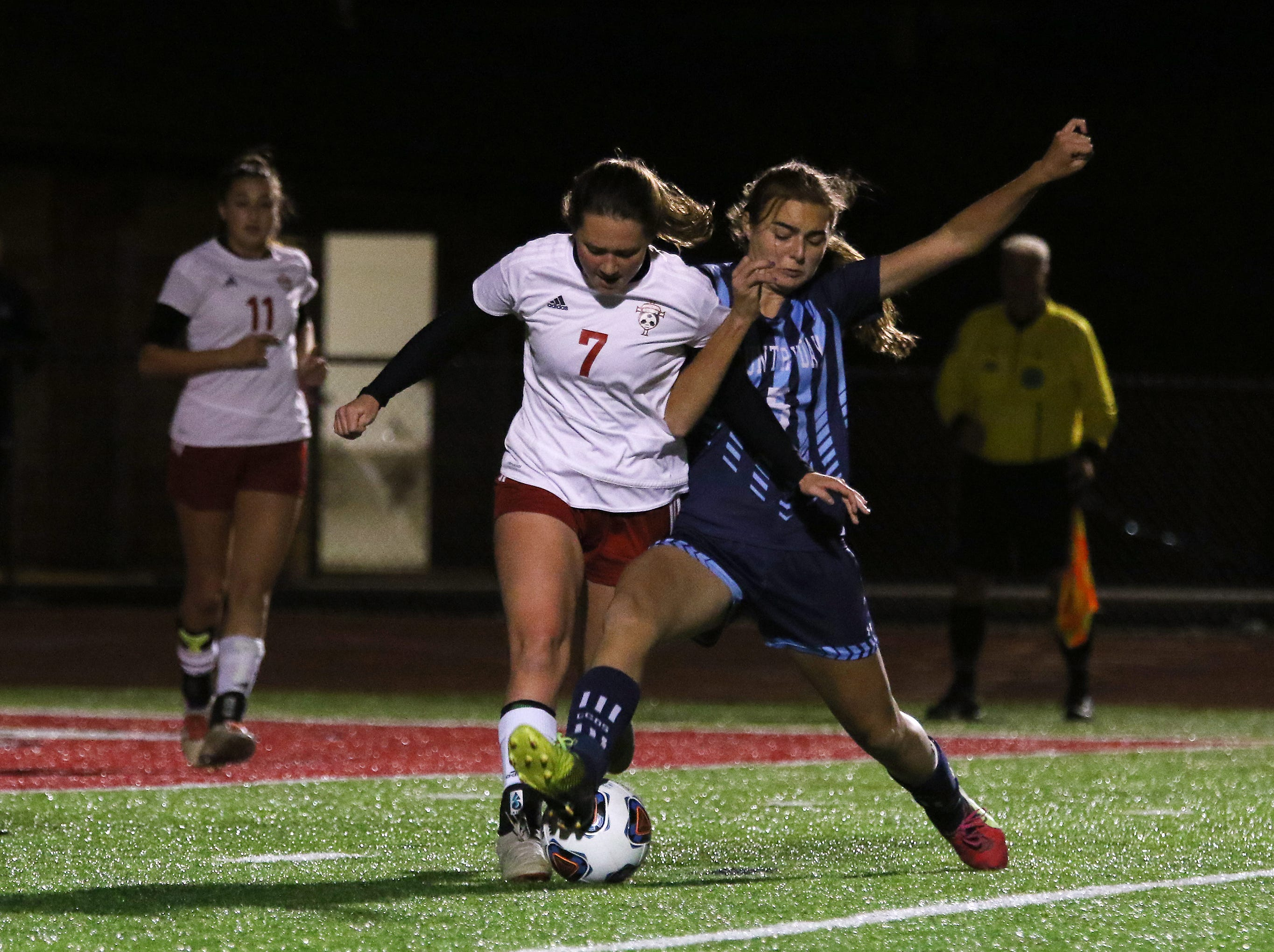 Rosecrans' Allie Berry battles for the ball against CCD in the Division III state semifinals at London High School on Tuesday.