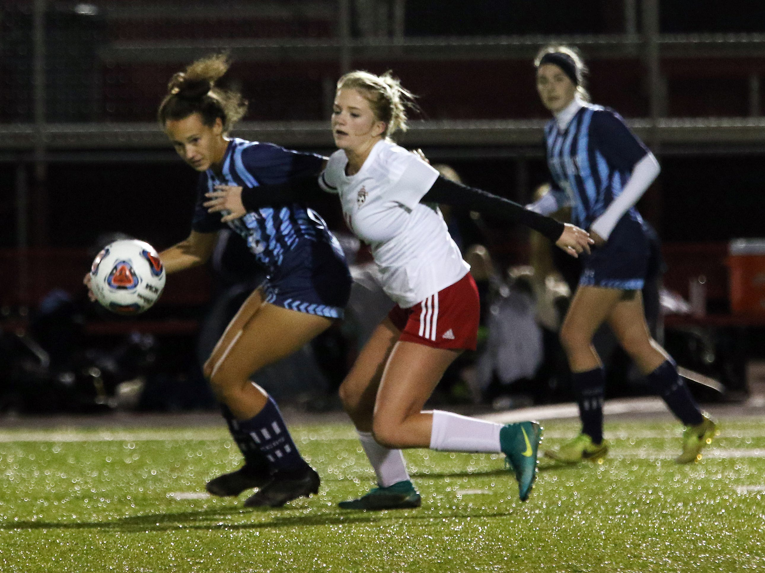Rosecrans' Emma Zemba fights for the ball against CCD in the Division III state semifinals at London High School on Tuesday.
