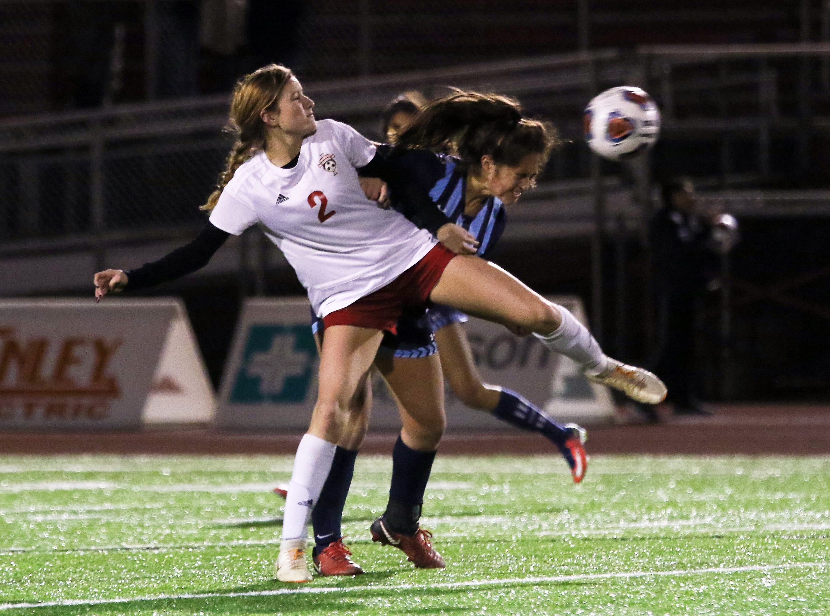Claire Creeks fights for the ball against CCD in the Division III state semifinals at London High School on Tuesday.