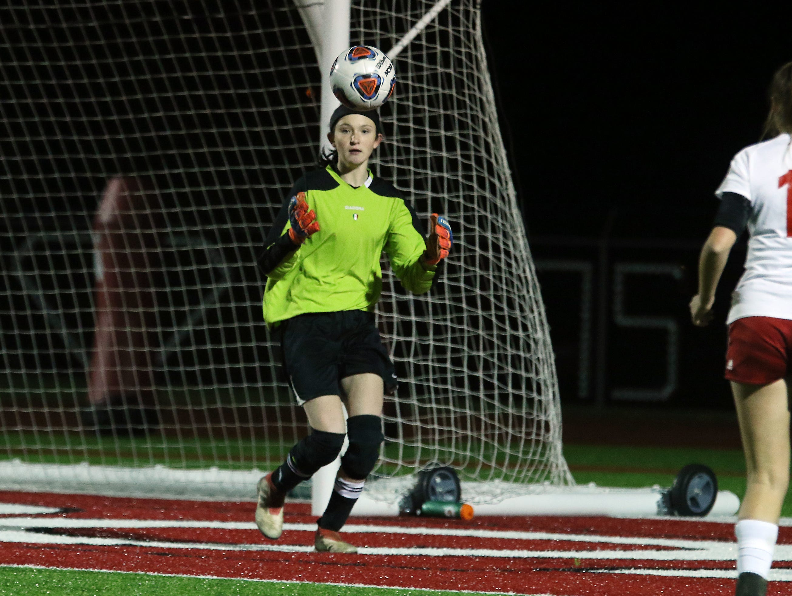 Rosecrans' Makaela McLoughlin makes a save against CCD in the Division III state semifinals at London High School on Tuesday.