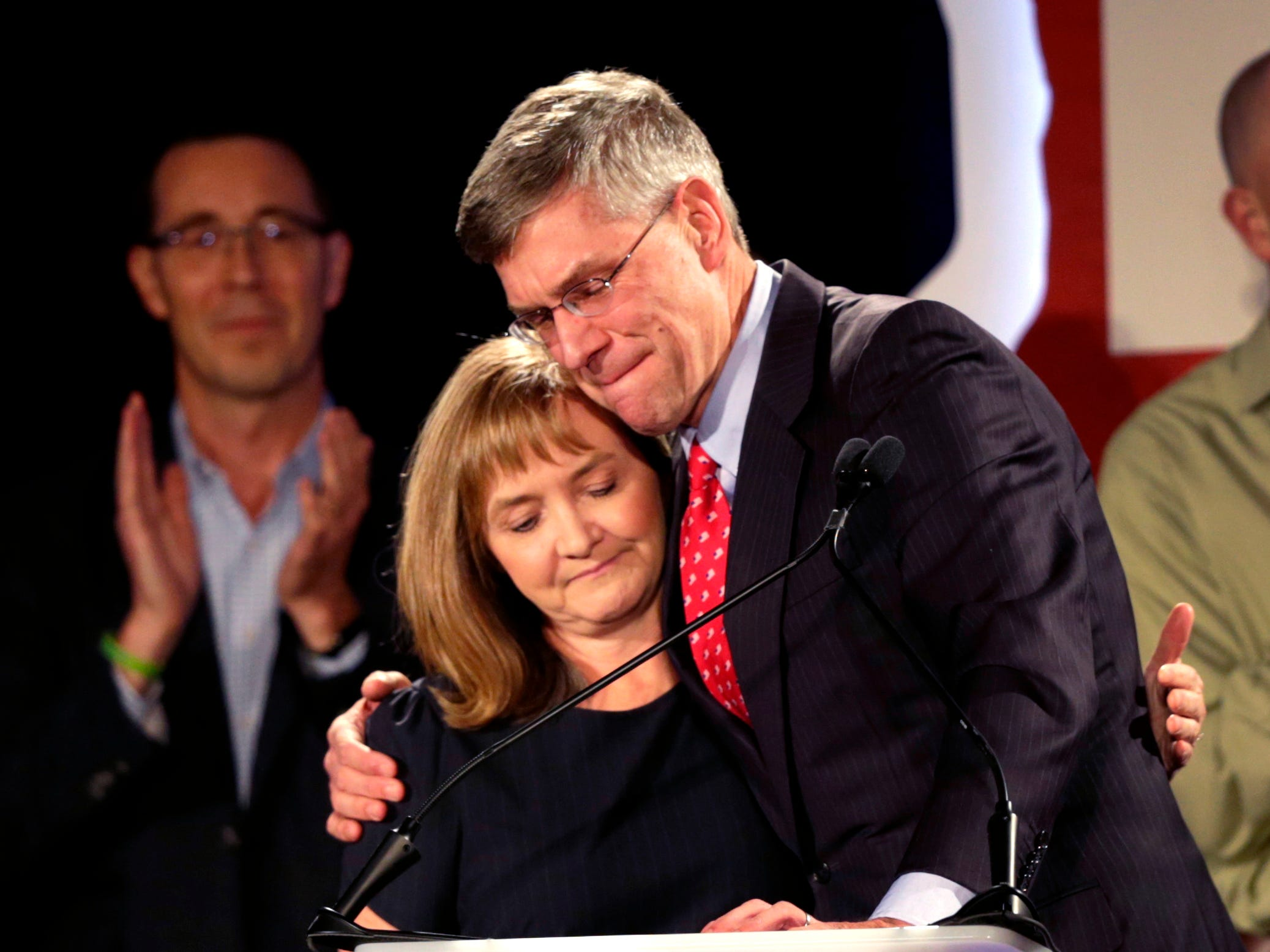 U.S. Rep. Erik Paulsen, running in Minnesota's 3rd Congressional District race, hugs his wife, Kelly, after making his concession speech at his Republican election night party Tuesday, Nov. 6, 2018, in Bloomington, Minn.