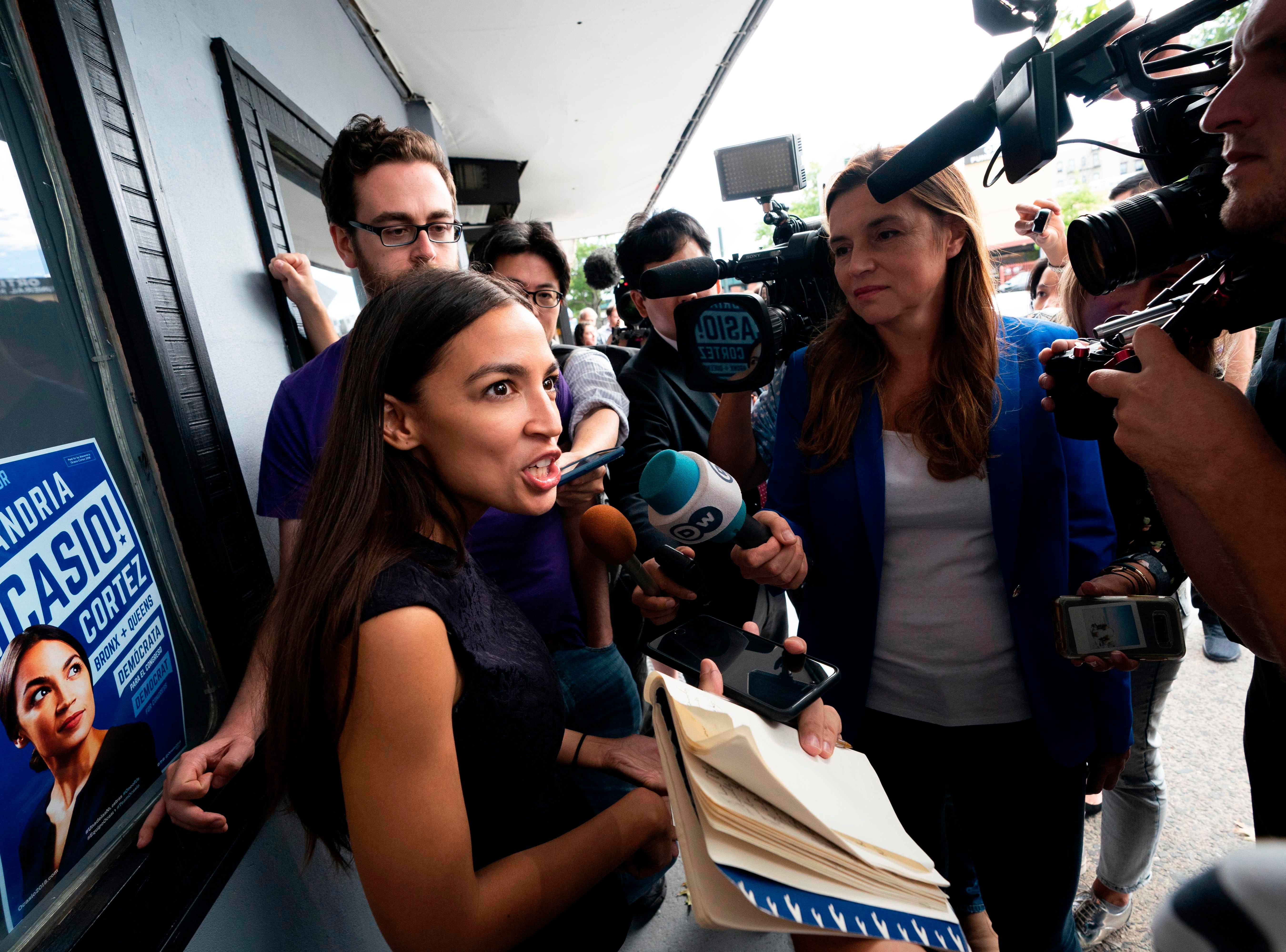 Democratic congressional candidate Alexandria Ocasio-Cortez speaks with  reporters after her general campaign kick-off rally in the Bronx borough of New York on Sept. 22, 2018.