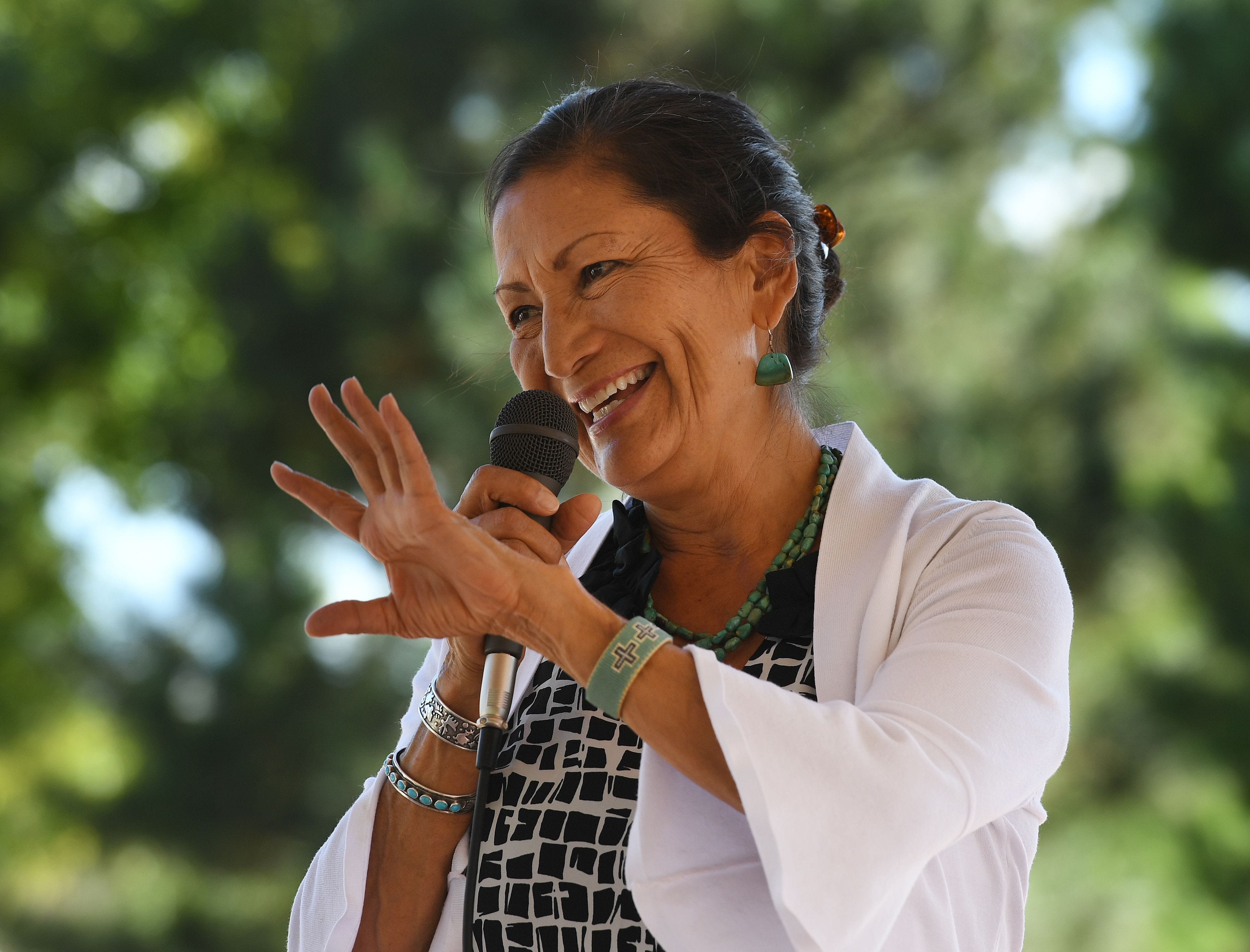 In this file photo taken on Sept. 30, 2018 Native American candidate Deb Haaland who is running for Congress in New Mexico's 1st congressional district seat for the upcoming midterm elections, speaks in Albuquerque, New Mexico. Democrat candidates Sharice Davids and Deb Haaland broke new ground on November 6, 2018, becoming the first Native American women elected to Congress, US networks projected. Haaland, 57, of New Mexico, beat Janice Arnold-Jones, a Republican, and Lloyd Princeton, a Libertarian.