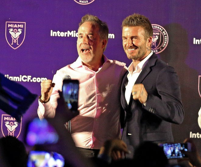 Jorge Mas (left) and David Beckham celebrate after Miami voters gave city officials permission to negotiate a no-bid lease deal with Beckham's group.