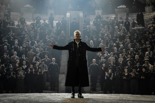 Dark wizard Gellert Grendelwald (Johnny Depp) gathers followers for his sinister ideology.
