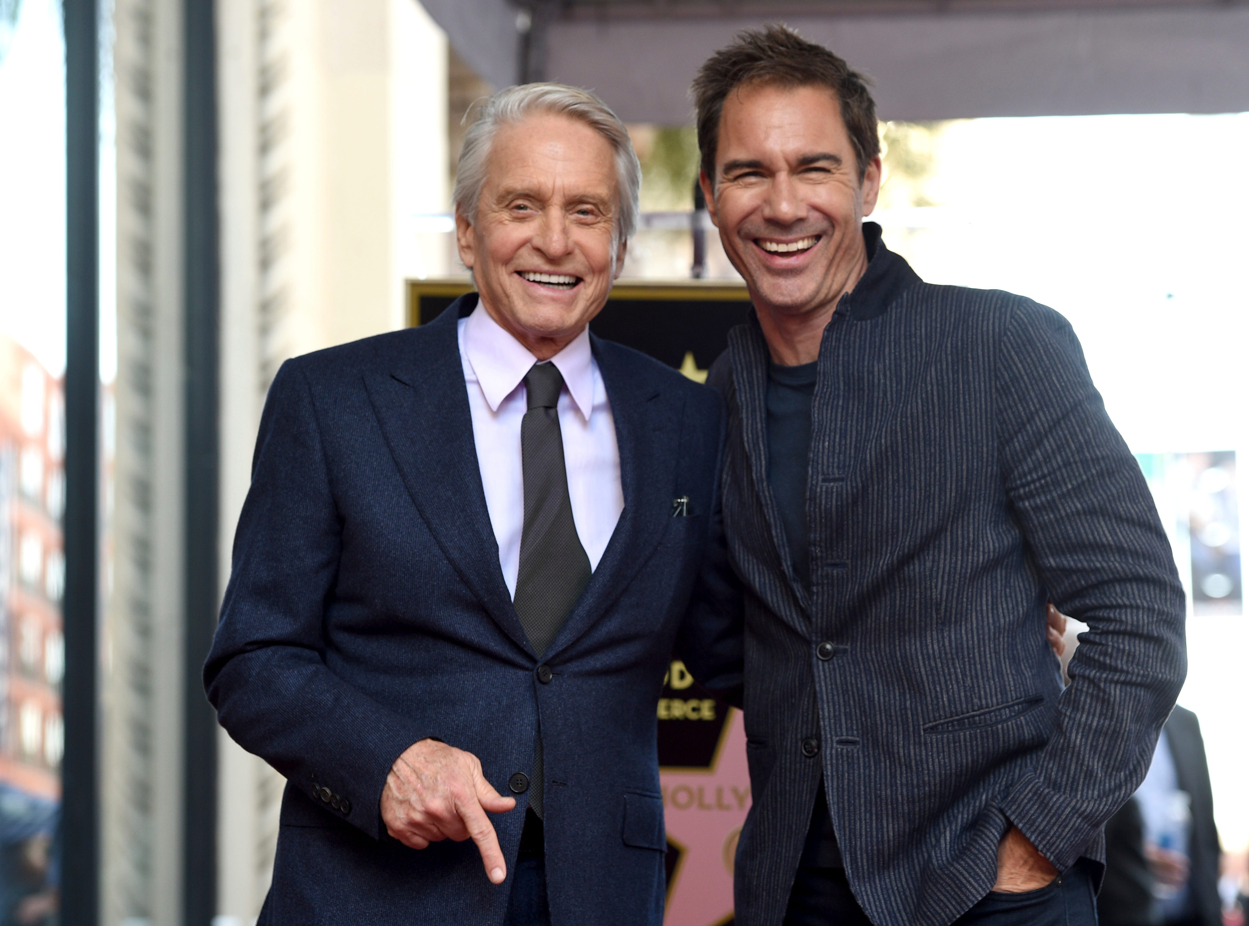 """Michael Douglas joked that his best onscreen love interest was in the audience, """"Will and Grace"""" co-star Eric McCormack. Douglas was at McCormack's Walk of Fame ceremony, too."""