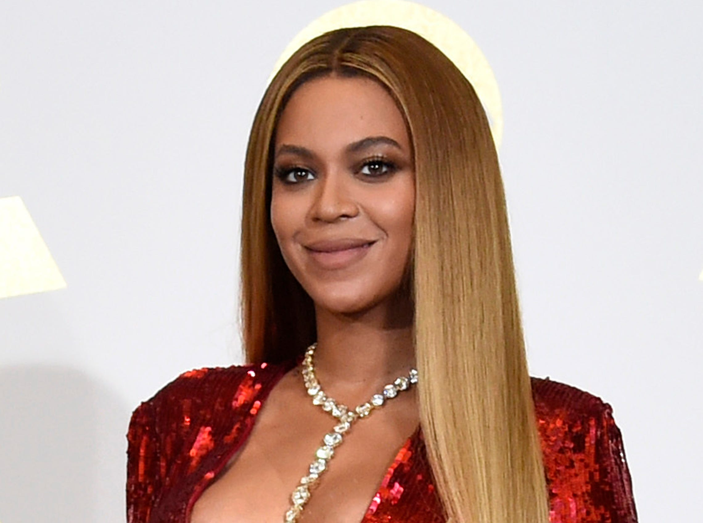"FILE - In this Feb. 12, 2017 file photo, Beyonce poses in the press room at the 59th annual Grammy Awards in Los Angeles. The singer reveals she had an emergency Caesarean section when she delivered her twins. In a series of essays in September's Vogue magazine, she says she was 218 pounds and was swollen from toxemia. The 36-year-old says they spent many weeks in intensive care and her husband, Jay Z, was ""such a strong support system."" (Photo by Chris Pizzello/Invision/AP, File) ORG XMIT: NYET103"