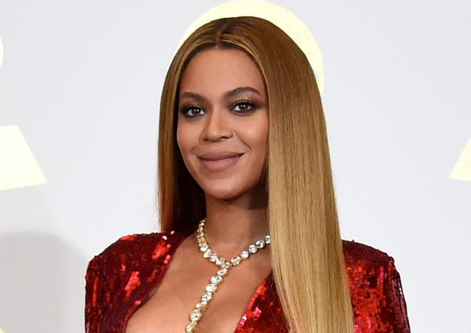 Beyonce poses in the press room at the 59th annual Grammy Awards in Los Angeles.