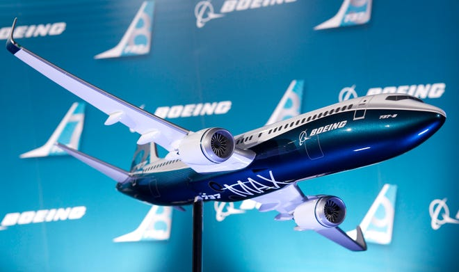 This file photo from Aug. 30, 2011, a shows a model of Boeing's 737 Max narrowbody jet.