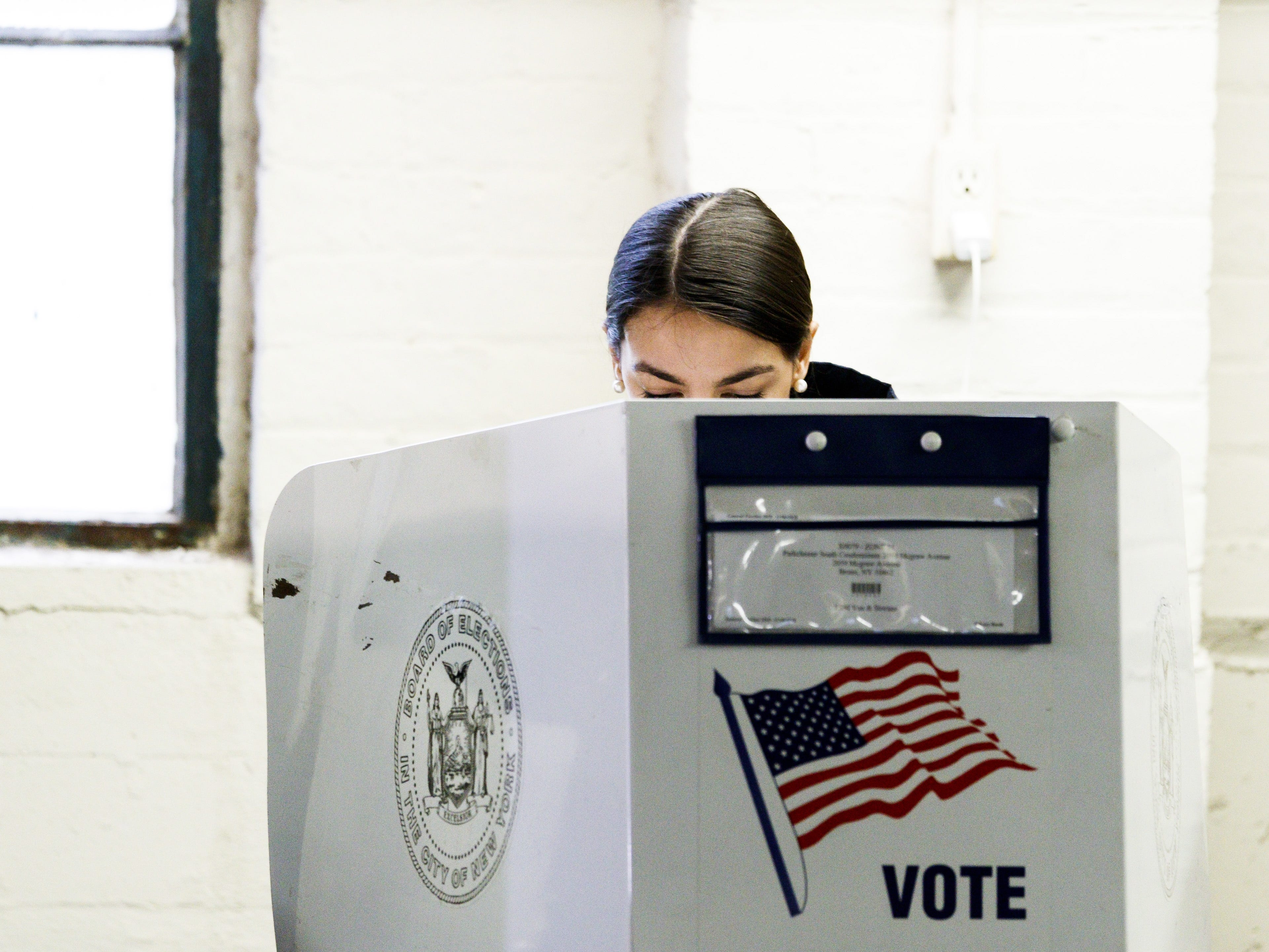 Alexandria Ocasio-Cortez, who is running as the Democratic nominee for New York's 14th congressional district, casts her ballots in the 2018 mid-term general election at a polling site in the Bronx, New York on Nov. 6, 2018.
